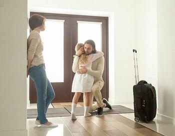 parent hugging child before moving